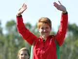 Wales's silver medalist Elena Allen celebrates on the podium at the medal ceremony for the women's Skeet at Barry Buddon Shooting Centre during the 2014 Commonwealth Games in Carnoustie, Scotland on July 25, 2014