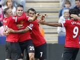 Manchester United's Dutch striker Robin van Persie celebrates scoring the opening goal with teammates during the English Premier League football match between Leicester City and Manchester United at the King Power Stadium in Leicester on September 21, 201