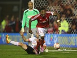 Britt Assombalonga of Nottingham Forest celebrates after scoring their fourth goal and his hattrick during the Sky Bet Championship match between Nottingham Forest and Fulham at the City Ground on September 17, 2014