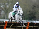 Richie McGrath riding Stopped Out clear the last to win The bet365 Handicap Hurdle Race at Sandown racecourse on April 27, 2013