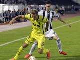 Harry Kane of Tottenham Hotspur is challenged by Danilo Pantic of Partizan during the UEFA Europa League match between Partizan and Tottenham Hotspur at the Stadium JNA on September 18,