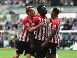 Southampton player Victor Wanyama celebrates with team mates after scoring the first goal during the Barclays Premier League match between Swansea City and Southampton at Liberty Stadium on September 20, 2014