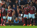 Diafra Sakho #15 of West Ham is congratulated by teammates after scoring his team's second goal during the Barclays Premier League match between West Ham United and Liverpool at Boleyn Ground on September 20, 2014