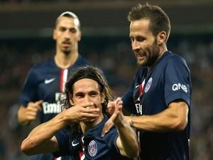 Paris Saint-Germain's Uruguayan forward Edinson Cavani celebrates a goal against Lyon on September 21, 2014