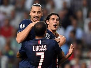Paris Saint-Germain's Edinson Cavani celebrates with teammates Zlatan Ibrahimovic and Lucas after scoring during the UEFA Champions League football match Ajax Amsterdam vs Paris Saint-Germain (PSG) in Amsterdam, on September 17, 2014