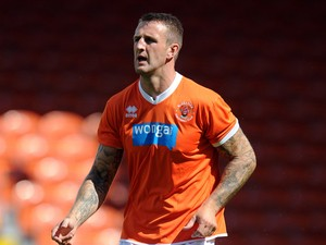 Peter Clarke of Blackpool in action during the Pre Season Friendly match between Blackpool and Burnley at Bloomfield Road on August 2, 2014