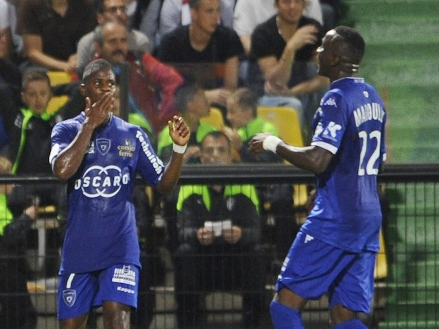 Bastia's French Togolese midfielder Floyd Ayite (L) andmidfielder Christopher Maboulou (R) celebrate after scoring against Metz on September 20, 2014