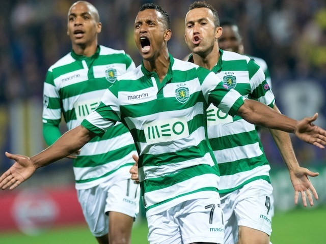 Sporting Lisbon's Nani (C) celebrates with teammates after scoring during the UEFA Group G Champions League footbal match NK Maribor vs Sporting Lisbon in Maribor, Slovenia on September 17, 2014