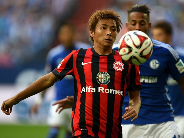 Schalke's defender Dennis Aogo and Frankfurt's Japanese midfielder Takashi Inui vie for the ball during the German first division Bundesliga football match FC Schalke 04 vs Eintracht Frankfurt at the Veltins Arena in Gelsenkirchen, western Germany on Sept