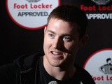 NBA player Aron Baynes speaks to the media during a Footlocker in store appearance on July 15, 2014