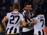 Cyril Thereau (C) of Udinese celebrates with team mates after scoring the opening goal during the Serie A match against SS Lazio on September 25, 2014