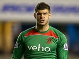 Southampton goalkeeper Fraser Forster looks on during the Capital One Cup Second Round match between Millwall and Southampton at The Den on August 26, 2014