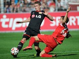Leverkusen's midfielder Lars Bender vies with Freiburg's midfielder Julian Schuster during the German first division Bundesliga football match SC Freiburg vs Bayer 04 Leverkusen in Freiburg, southwestern Germany on September 27, 2014
