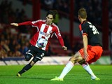 Jota attacks for Brentford during the Capital One Cup Second Round match between Brentford