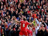 Steven Gerrard #8 of Liverpool infront of the home fans after scoring the opening goal from a free kick during the Barclays Premier League match between Liverpool and Everton at Anfield on September