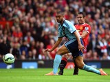 Robin van Persie of Manchester United shoots past Winston Reid of West Ham to score his team's second goal during the Barclays Premier League match between Manchester United and West Ham United at Old Trafford on September 27, 2014