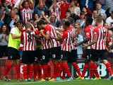 Ryan Bertrand (#21) of Southampton celebrates with his team-mates after scoring the opening goal during the Barclays Premier League match between Southampton and Queens Park Rangers at St Mary's Stadium on September 27, 2014
