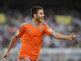 Valencia's midfielder Carles Gil celebrates after scoring during the Spanish league football match Real Sociedad vs Valencia CF at the Anoeta stadium in San Sebastian on September 28, 2014