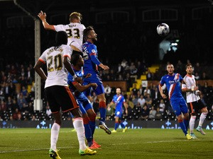 Dan Burn of Fulham scores his team's second goal during the Capital One Cup Third Round match between Fulham and Doncaster Rovers at Craven Cottage on September 23, 2014