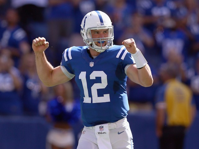 Andrew Luck #12 of the Indianapolis Colts celebrates after a touchdown during the game against the Tennessee Titans at Lucas Oil Stadium on September 28, 2014