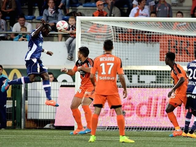 Evian's Ivorian Burkinabese midfielder Djakaridja Kone (L) scores a goal during the French L1 football match between Lorient (FCL) and Evian Thonon Gaillard (ETGFC) on September 27, 2014