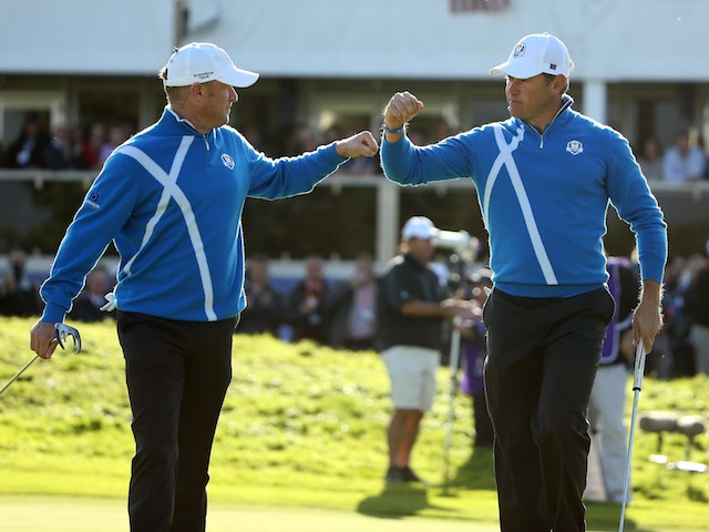Jamie Donaldson (L) and Lee Westwood of Europe celebrate as they leave the 12th green during the Afternoon Foursomes of the 2014 Ryder Cup on the PGA Centenary Course at Gleneagles on September 26, 2014