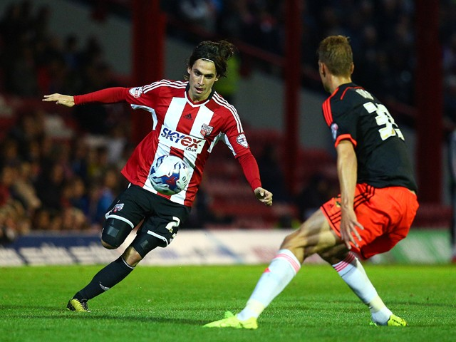 Jota attacks for Brentford during the Capital One Cup Second Round match between Brentford and Fulham at Griffin Park on August 26, 2014