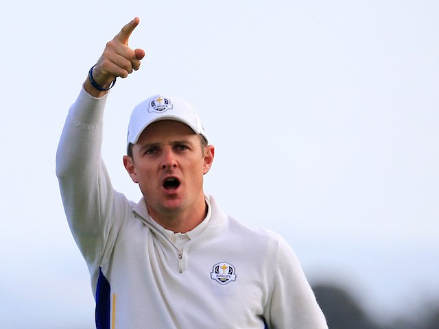 Justin Rose of Europe celebrates his putt to win the 8th hole during the Morning Fourballs of the 2014 Ryder Cup on the PGA Centenary course at Gleneagles on September 27, 2014