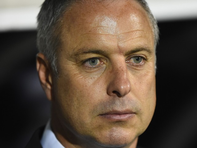 Fulham caretaker manager Kit Symons looks on during the Capital One Cup Third Round match between Fulham and Doncaster Rovers at Craven Cottage on September 23, 2014