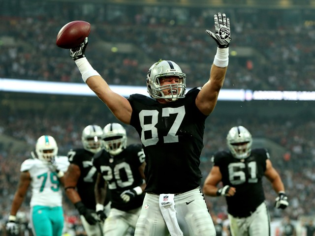 Brian Leonhardt #87 of the Oakland Raiders celebrates after after making a reception to score the game's opening touchdown during the NFL match between the Oakland Raiders and the Miami Dolphins at Wembley Stadium on September 28, 2014