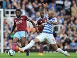 West Ham United's Cameroonian midfielder Alex Song (L) vies with Queens Park Rangers' Brazilian midfielder Sandro (R) during the English Premier League football match