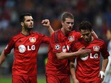 Leverkusen's midfielder Hakan Calhanoglu, Leverkusen's midfielder Lars Bender and Leverkusen's Bosnian defender Emir Spahic celebrate during the first leg UEFA Champions League Group C football match Bayer 04 Leverkusen vs SL Benfica in Leverkusen, wester