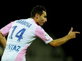 Evian's French midfielder Cedric Barbosa jubilate after scoring a goal during their French L1 football match Evian Thonon Gaillard against Metz (FC) on October 4, 2014