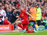 Jordan Henderson of Liverpool celebrates scoring their second goal during the Barclay