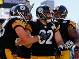 Michael Palmer #82 of the Pittsburgh Steelers celebrates with teammates after scoring a touchdown during the second quarter of the game against the Jacksonville Jaguars on October 5, 2014