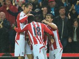 Peter Crouch of Stoke City celebrates with team-mates after scoring the opening goal during the Barclays Premier League match between Stoke City and Newcastle United at Britannia Stadium on September 29, 2014