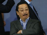 Cardiff FC owner Vincent Tan looks on during the UEFA Super Cup match between Real Madrid and Sevilla at Cardiff City Stadium on August 12, 2014