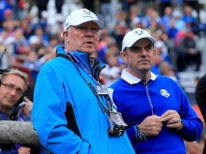 Europe team captain Paul McGinley and Sir Alex Ferguson in discussion during the Singles Matches of the 2014 Ryder Cup on the PGA Centenary course at the Gleneagles Hotel on September 28, 2014
