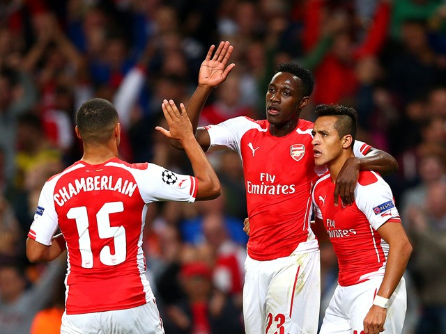 Danny Welbeck of Arsenal celebrates with team-mates Alex Oxlade-Chamberlain and Alexis Sanchez after scoring the opening goal during the UEFA Champions League group D match between Arsenal FC and Galatasaray AS at Emirates Stadium on October 1, 2014