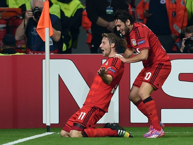 Leverkusen's midfielder Hakan Calhanoglu and Leverkusen's forward Stefan Kiessling celebrate during the first leg UEFA Champions League Group C football match Bayer 04 Leverkusen vs SL Benfica in Leverkusen, western Germany on October 1, 2014