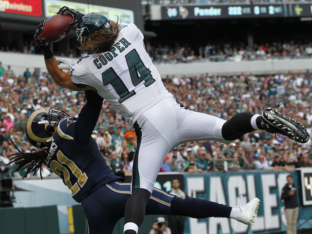 Wide receiver Riley Cooper #14 of the Philadelphia Eagles catches a touchdown pass in the second quarter with defensive back Janoris Jenkins #21 of the St. Louis Rams on October 5, 2014