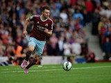 Carl Jenkinson of West Ham United in action during the Barclays Premier League match between West Ham United and Queens Park Rangers at Boleyn Ground on October 5, 2014