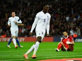 Danny Welbeck of England celebrates scoring their third goal as goalkeeper Aldo Simoncini of San Marino looks dejected during the EURO 2016 Group E Qualifying match on October 9, 2014