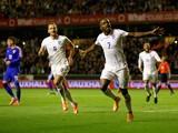Saido Berahino of England runs away to celebrate after scoring his teams second goal from the penalty spot during the UEFA U21 Championship Playoff First Leg match between England and Croatia at Molineux on October 10, 2014