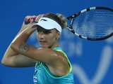 Karolina Pliskova of Czech in action during her match against Petra Kvitova of Czech on day four of 2014 Dongfeng Motor Wuhan Open at Optics Valley International Tennis Center on September 24, 2014