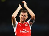 Per Mertesacker of Arsenal celebrates at the end of the UEFA Champions League Qualifier 2nd leg match between Arsenal and Besiktas at the Emirates Stadium on August 27, 2014
