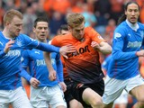 Steven Smith of Rangers chases down Stuart Armstrong of Dundee United during the William Hill Scottish Cup Semi Final between Rangers and Dundee United at Ibrox Stadium on April 12, 2014