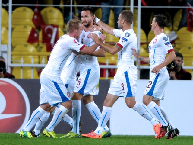 Czech Republic's Tomas Sivok celebrates with teammmates after scoring against Turkey during the UEFA Euro 2016 Group A qualifying football match Turkey vs Czech Republic on October 10, 2014