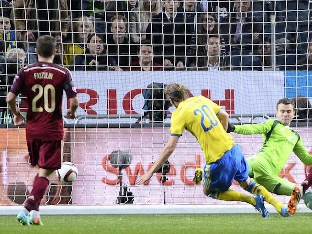 Sweden's forward Ola Toivonen scores past Russia's goalkeeper Igor Akinfeev on October 9, 2014