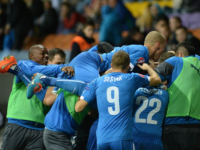 Slovakia's players celebrate after scoring during the UEFA Euro 2016 qualifying football match between Belarus and Slovakia in Borisov some 100 km from Minsk on October 12, 2014